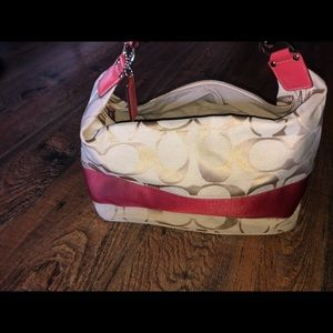 Coach pink and tan hobo bag